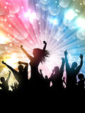 Party crowd background. Silhouette of a party crowd on a starburst background Royalty Free Stock Images