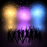 Party crowd on fireworks background. Silhouettes of people dancing on a fireworks background Royalty Free Stock Photos
