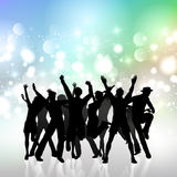 Party crowd. Silhouette of a party crowd on a bokhe lights background Royalty Free Stock Photography