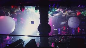 Party in crowded nightclub. People dance. Dj at turntable. Spotlights. Go go. stock video