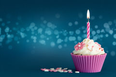 Party cupcake with candle Stock Photos