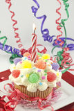 Party Cupcake With Lit Candle Royalty Free Stock Image