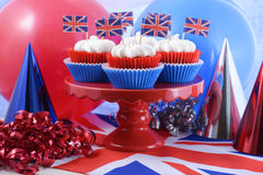 Party cupcakes with UK flags. Holiday party cupcakes with UK flags and red, white and blue party hats and balloons Stock Photography