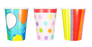 Party cups. A set of disposable, paper party cups for birthdays and other celebrations and parties.  Isolated on a white background Royalty Free Stock Photo