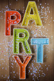 Party 3D typeface. 3D typeface of word party on wood Stock Image