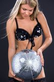 Party dancer in black lingerie with disco ball Stock Image