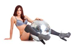 Party dancer on high heels with disco ball Stock Image