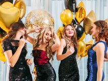 Party dancing girls flaunting festive hairstyle royalty free stock photos