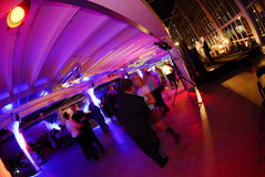Party dancing hall. View of modern hall with party going on in the background Stock Image