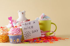 Party decoration. Cupcake with mug and message have a nice day Stock Image