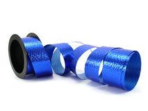Party decoration ribbon. Blue party decoration ribbon isolated on white Royalty Free Stock Photography