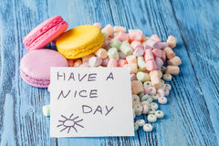 Party decoration. Sweets, marshmallow and note have a nice day Stock Image
