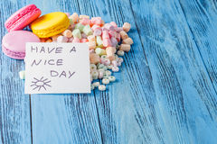 Party decoration. Sweets, marshmallow and note have a nice day Stock Photos