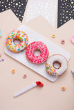 Party. Different colourful sugary round glazed donuts and bottle Royalty Free Stock Photos