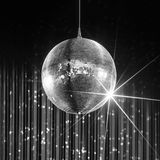 Party disco ball. With stars in nightclub with striped walls lit by spotlight, nightlife entertainment industry, monochrome Royalty Free Stock Photo