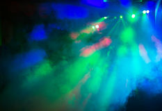 Party disco lights background. Colorful disco party laser lights and smoke background, blue and green stock photos