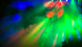 Party disco lights background. Colorful disco party laser lights and smoke background, red, blue and green Royalty Free Stock Photo