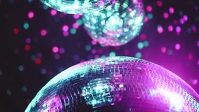 Party disco mirror balls. Beautiful mirror balls rotates under the ceiling. Night disco party concept stock video footage