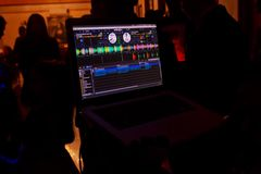 Party dj audio equipment on scene in club.Bright concert lighting.Disc jockey plays music show,mix tracks.Entertainment event in n royalty free stock images