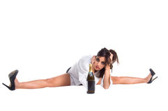 Party Doll. Young woman doing the splits Royalty Free Stock Images