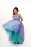 Party dress. Teenage girl lifting party dress Royalty Free Stock Photography