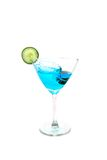 Party drink. Blue martini olive splash in glass Royalty Free Stock Images