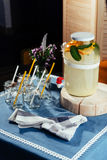 Party drink station with small bottles and homemade lemonade Stock Photo