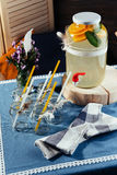 Party drink station with small bottles and homemade lemonade Royalty Free Stock Photography