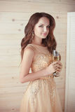 Party, drinks. Beautiful elegant woman in evening dress with cha Stock Images