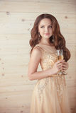 Party, drinks. Beautiful elegant woman in evening dress with gla Royalty Free Stock Photos