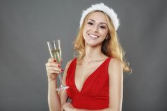 Party, drinks, christmas, x-mas concept - smiling woman in red d Royalty Free Stock Photos
