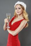 Party, drinks, christmas, x-mas concept - smiling woman in red d Stock Photography