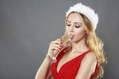 Party, drinks, christmas, x-mas concept - smiling woman in red d Royalty Free Stock Photo