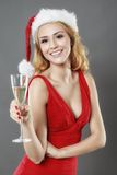 Party, drinks, christmas, x-mas concept - smiling woman in red d Royalty Free Stock Images