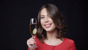 Happy smiling woman with glass of champagne stock footage