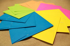 Party envelopes. Colorful envelopes lie creatively placed in a spinning circle, calling for lots of fun stock photo