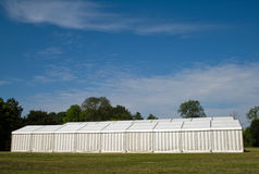 A party or event tent. A white party or event tent on a meadow in a public park Stock Photo