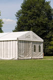 A party or event tent. A white party or event tent on a meadow in a public park Stock Images