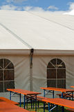 A party or event tent. A white party or event tent with beer tables and benches Royalty Free Stock Photos