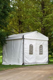 A party or event tent. A white party or event tent on a meadow in a public park Royalty Free Stock Photo