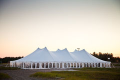 A party or event white tent. Party or event white tent during the evening Stock Photography