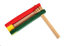 Party Favor Noise Maker. Green and Red wooden party favor noise maker stock photos