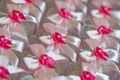 Party favors. Pink party favor boxes with bows and pearl Royalty Free Stock Image