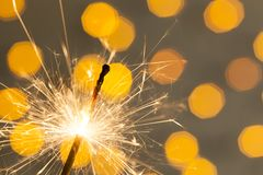 Party Feeling with Sparklers on Yellow Background. New year working Royalty Free Stock Images