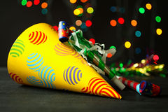 Party, festive hat on New Year's background. Festive hat on Background of Christmas lights garlands royalty free stock image