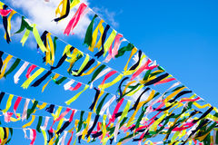 Party flags blue, red, green yellow. Royalty Free Stock Image