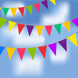 Party flags with blue sky and white clouds. Royalty Free Stock Photography