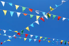 Party flags. Colourful party flags against blue sky at Camden Town Market, London Stock Photography