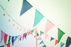 Party flags on the sky with vintage filter Royalty Free Stock Images