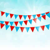 Party flags on sunny background Royalty Free Stock Images